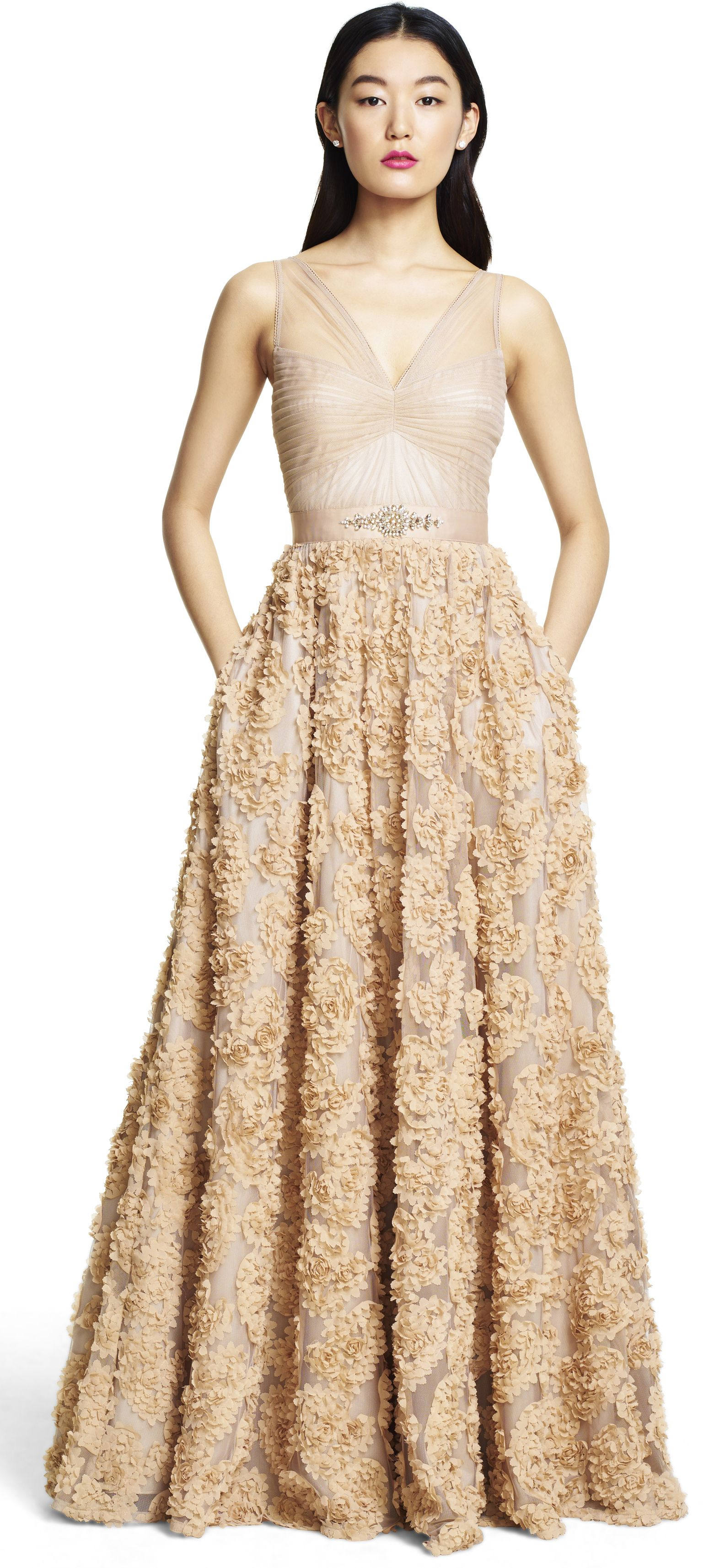 Elegant and ethereal tulle is used throughout the bodice of this