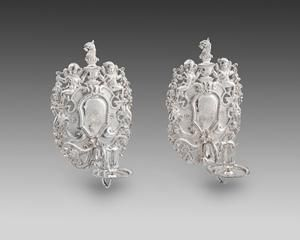 An Extremely  Fine Pair of Queen Anne Wall Sconces  John Fawdery  Son of John Fawdery of Enstone in the County of Oxford yeoman, apprenticed to Anthony Nelme 16 January 1688. Free, 11 September 1695. Mark entered as largeworker, undated, probably April 1697 on commencement of register. Address: Foster Lane. Livery, April 1705. Signatory as 'working goldsmith' to the petition complaining of the competition of 'necessitous strangers', December 1711 & to that against assaying work of foreigners
