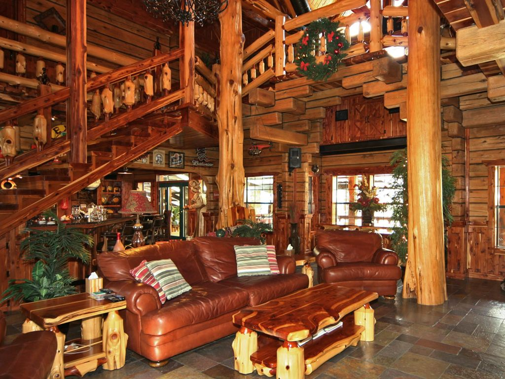 Catch cabin fever in these million dollar homes for Log cabin home builders in texas