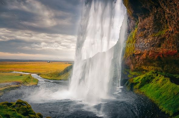 Landscape view of beautiful Seljalandsfoss waterfall in Iceland by martinm303. Landscape view of beautiful Seljalandsfoss waterfall in Iceland, Europe #AD #beautiful, #Seljalandsfoss, #Landscape, #view