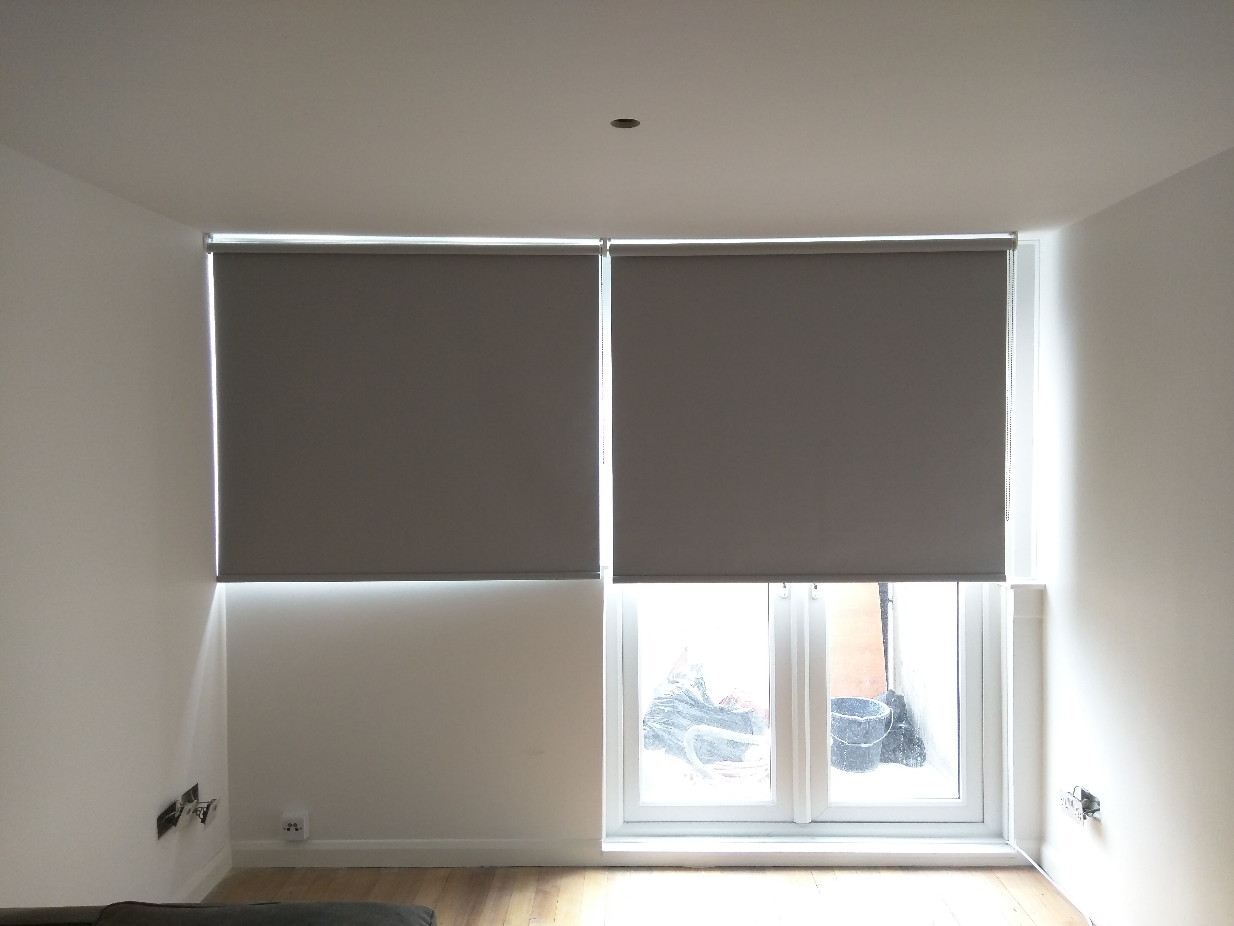 Blackout Roller Blinds Fitted To Living Room Windows And