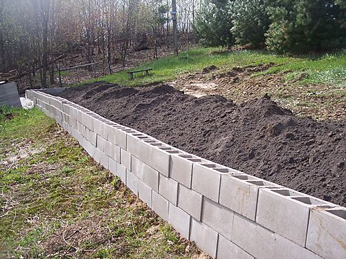 Retaining wall ideas cheap er retaining wall idea for Cheapest way to build a house foundation