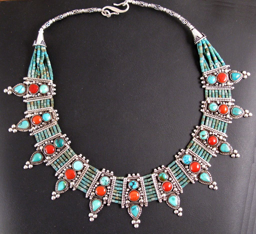 https://flic.kr/p/7MsMDD   7830b Turquoise & coral fine necklace, Nepal   Finely worked Necklace made from silver with coral and turquoise.  Handcrafted in Nepal using traditional Tibetan designs.     Further information or more images of individual pieces please contact us with image number:  Ann Porteus Sidewalk Tribal Gallery 19-21 Castray Esplanade, Battery Point 7004 Hobart Tasmania Australia ann@sidewalkgallery.com.au sidewalktribal.com t: 613 6224 0331  ABN 99 900 255 141