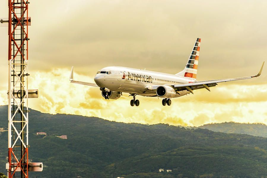 American Airlines aircraft landing during sunset at the Sangster ...