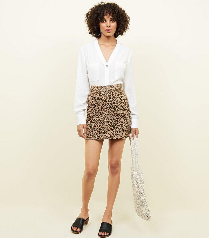 f890ab0cae Tan Leopard Print Denim Mini Skirt | Filming - Paris | Denim mini ...