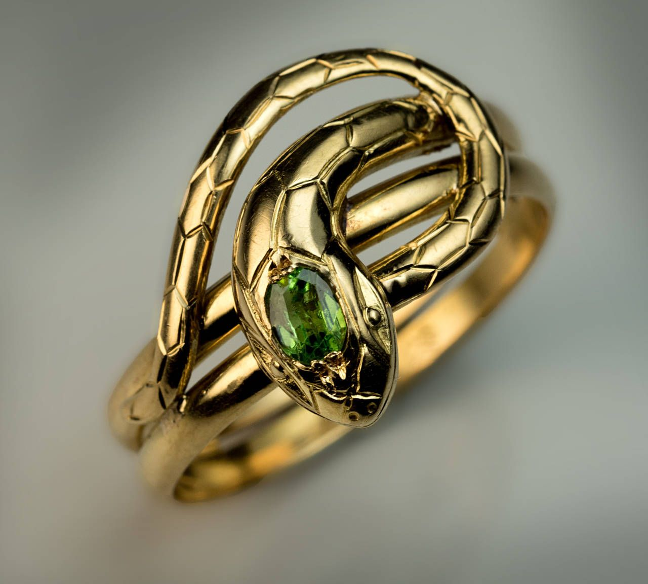 Antique Demantoid Gold Snake Ring | From a unique collection of vintage more rings at https://www.1stdibs.com/jewelry/rings/more-rings/