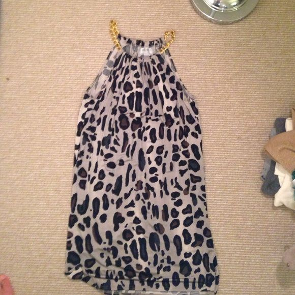 Cheetah print, gold dress. Cheetah print, gold dress. Size 10, but Truly fits on any size (I'm a 4 typically) Dresses