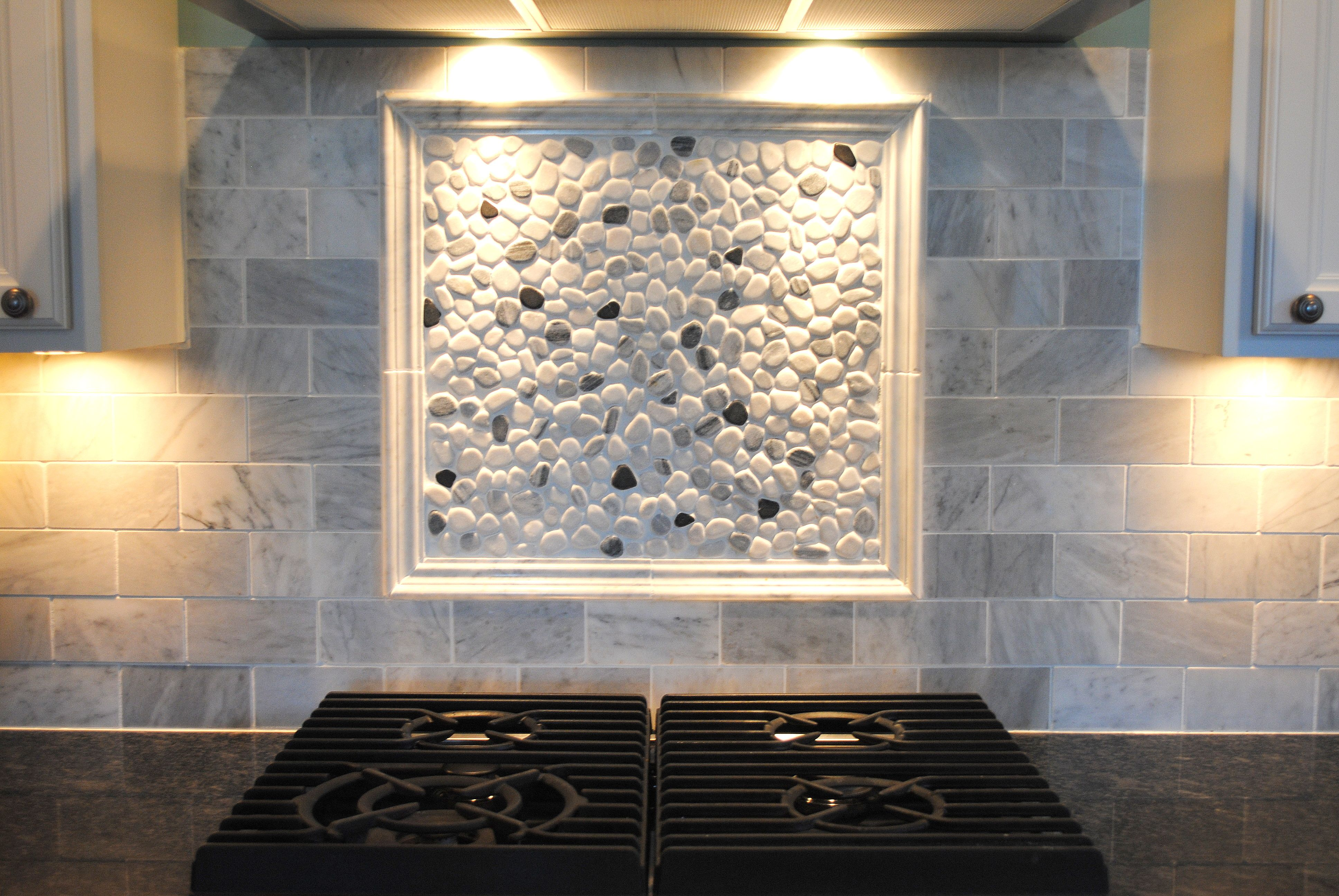 White Washed Tiles Backsplash With A Frame Containing White And