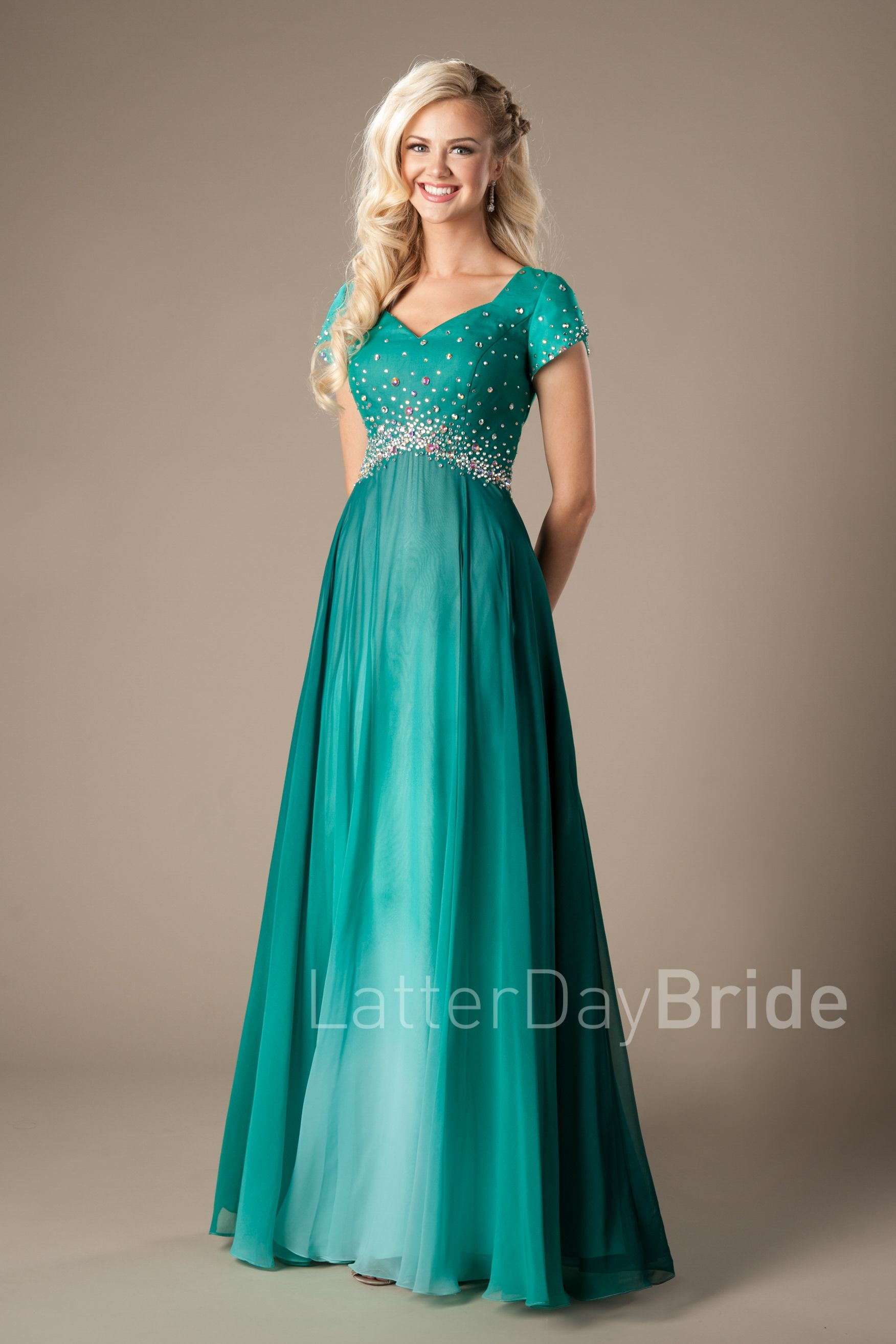 Green evening gown with sweetheart neckline and petal sleeves ...