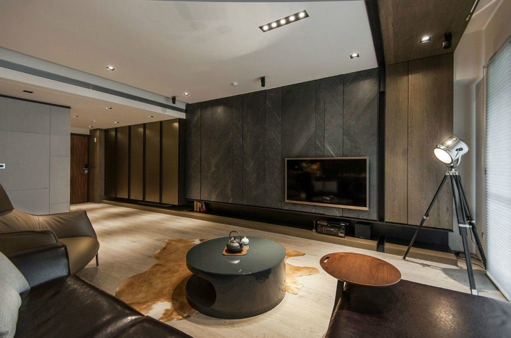 Masculine Interior With Stone And Wood Accents Acrylic Coffee Table Along With Dark Leather Sofa