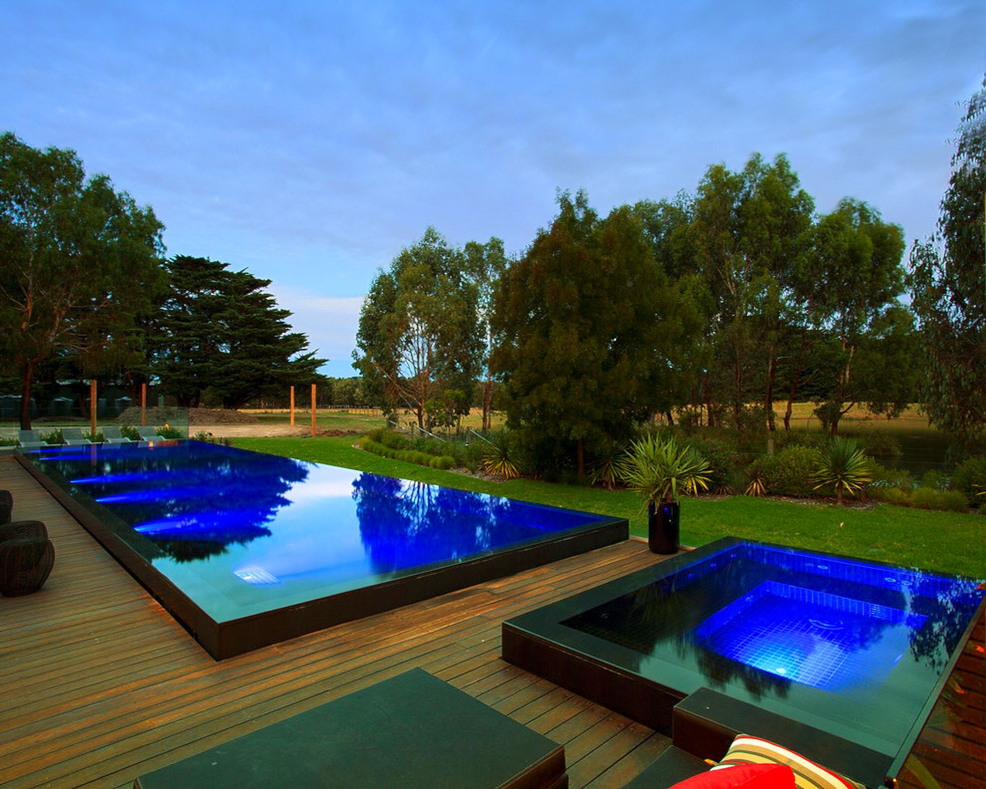 The swimming pool and spa were built with a continuous wet ...