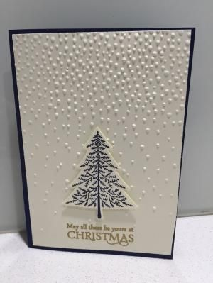 "Stampin' Up! Elegant Christmas card using Softly falling embossing folder with ""Peaceful pines"" and ""Versatile Christmas"" stamp sets with coordinating Night of Navy card stock and ink, Vanilla card stock and gold embossing powder. by pam.lemke.56"