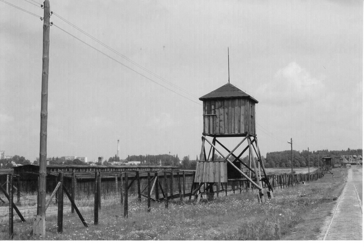 Majdanek watchtower and double barbed wire fence