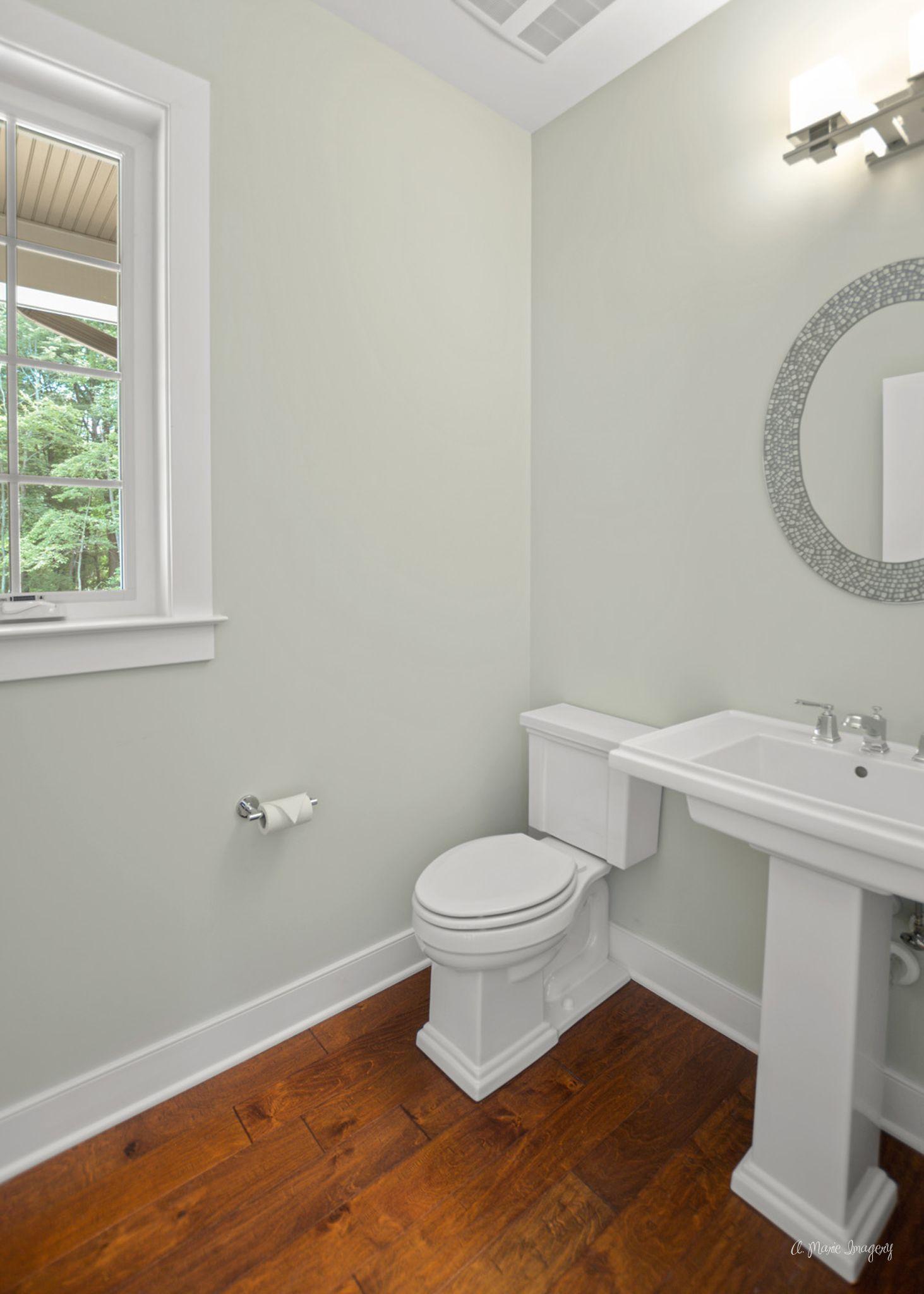 An Elegant Pedestal Sink And Matching Toilet Bring A Powder Room