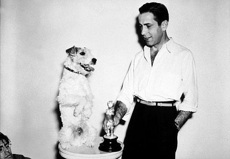 Humphrey Bogart with his dog and a dog award, circa 1934.
