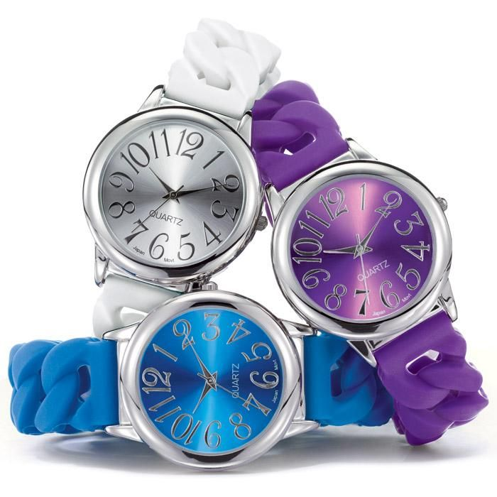 0adf5c4ff17 Ladies silicone stretch watch with a round silvertone case and colored sunray  dial that matches the strap. Available in blue dial