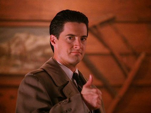 Actor Kyle MacLachlan reprises Agent Cooper on TikTok for Twin Peaks Day. In a funny new video, the actor re-creates the opening scene with hand-drawn car window and trees.