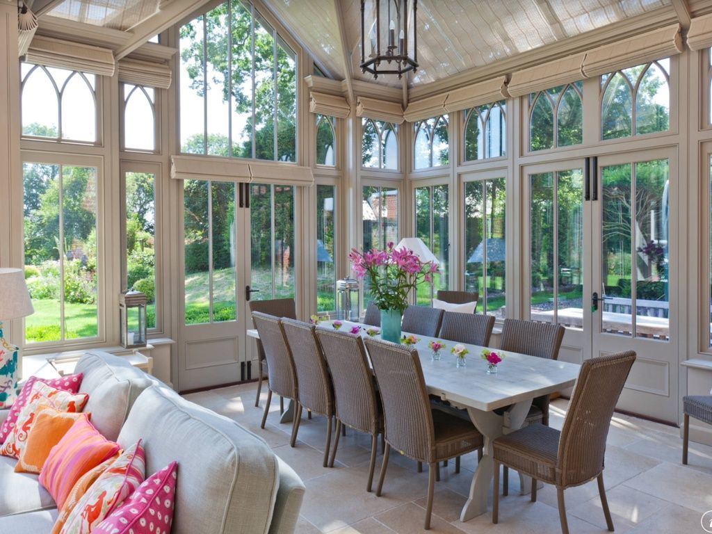 Attractice Sunroom Dining Room With Long White Table And Wicker Chairs Also Sofa Sets
