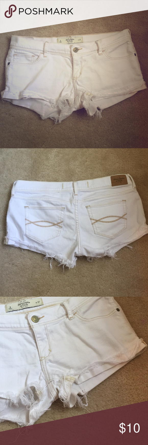 Abercrombie and Fitch white jean shorts Classic low-rise A&F shorts, gently used but in great condition--no stains! White stretchy denim with distressed, cuffed edges. Size 4/27. Abercrombie & Fitch Shorts Jean Shorts