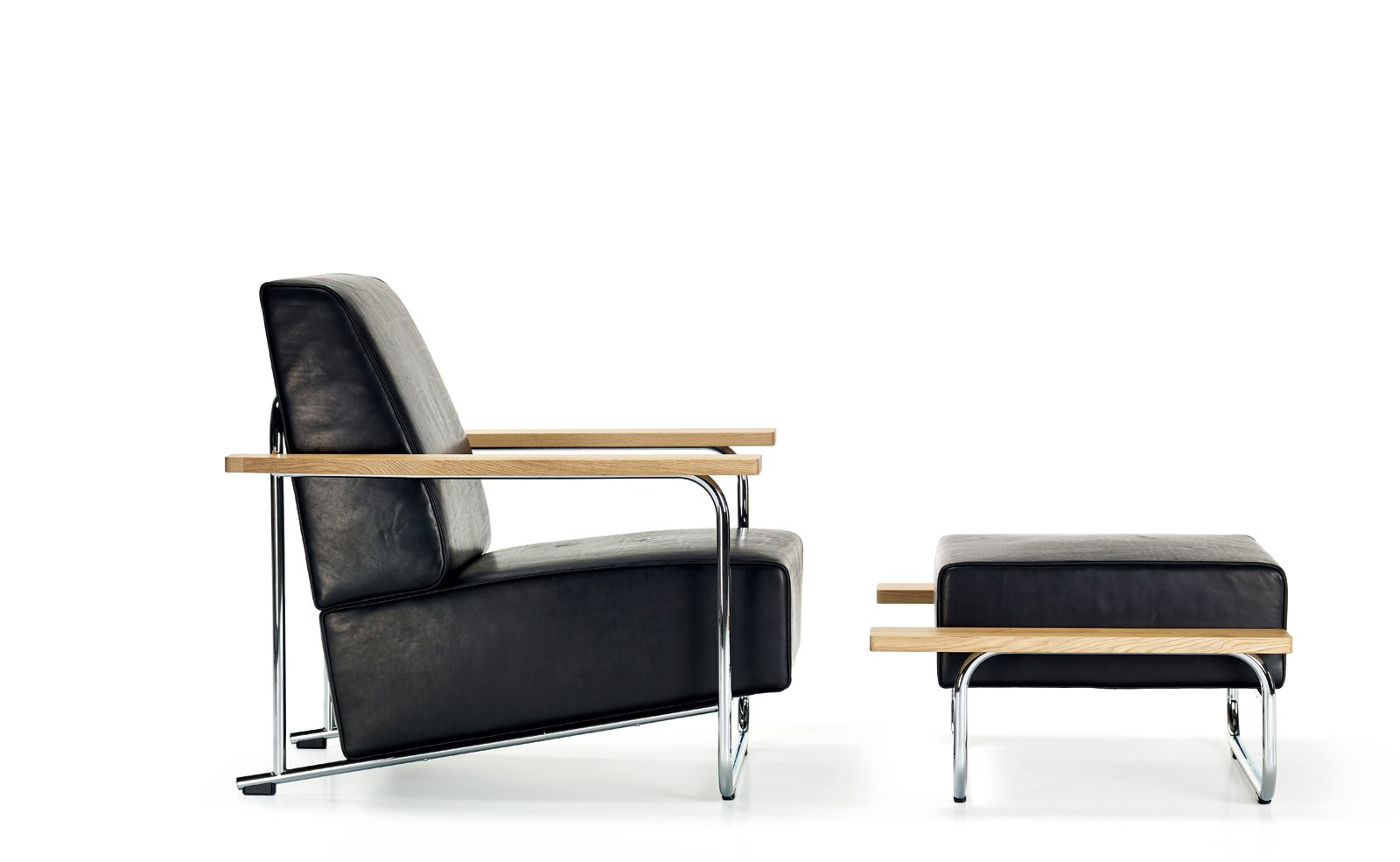 LOVELL EASY CHAIR + OTTOMAN Originally designed for the LOVELL HEALTH HOUSE in 1929, this version of EASY CHAIR only existed as a drawing until recently. While reminiscent of Bauhaus furniture, the organic solid oak armrests lend it a comfort and solidity all of its own.
