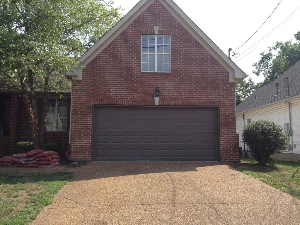 Brown painted brick houses best front door colors for for Painted garage doors pictures