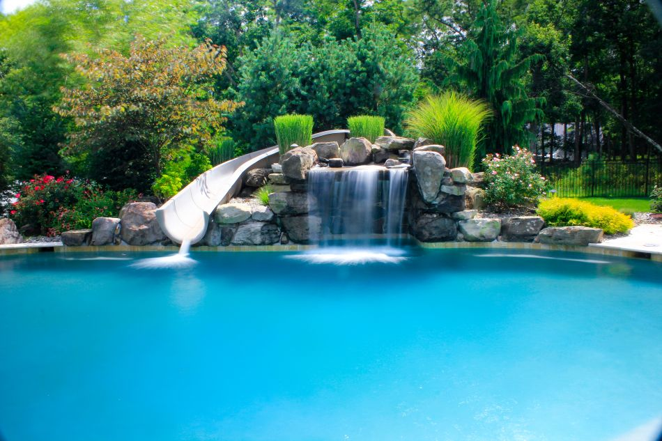 Pool Grottos Aquatic Artists Pool Waterfalls Nj Pa Ny De Md Pool Waterfall Pool Landscaping Swimming Pool Slides