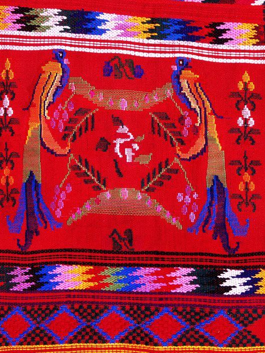 Quetzal bird embroidered on Mayan textile by MAYA MAYA