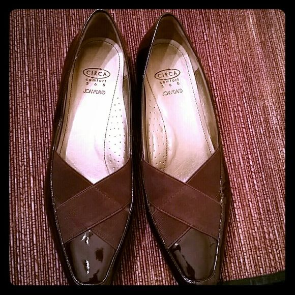 Joan & David Circa Comfort brown flats Brown patent leather flats with criss cross band accent. In excellent condition, soles show no signs of wear. Very comfortable shoes, feels like you're walking on a cloud! Joan & David Shoes Flats & Loafers