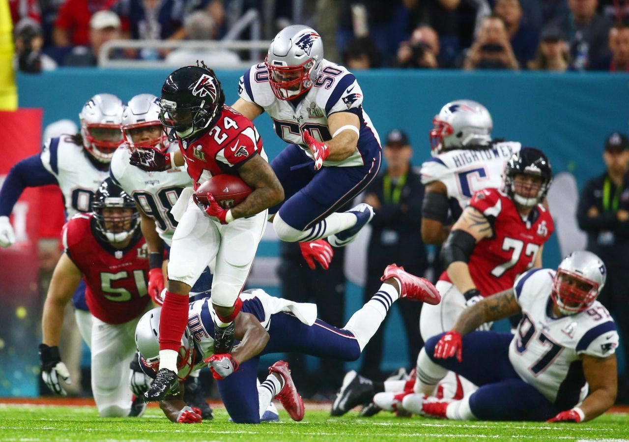 P Atlanta Falcons Running Back Devonta Freeman 24 Gets Away From New England Patriots Free Safety Duron Atlanta Falcons New England Patriots Devonta Freeman