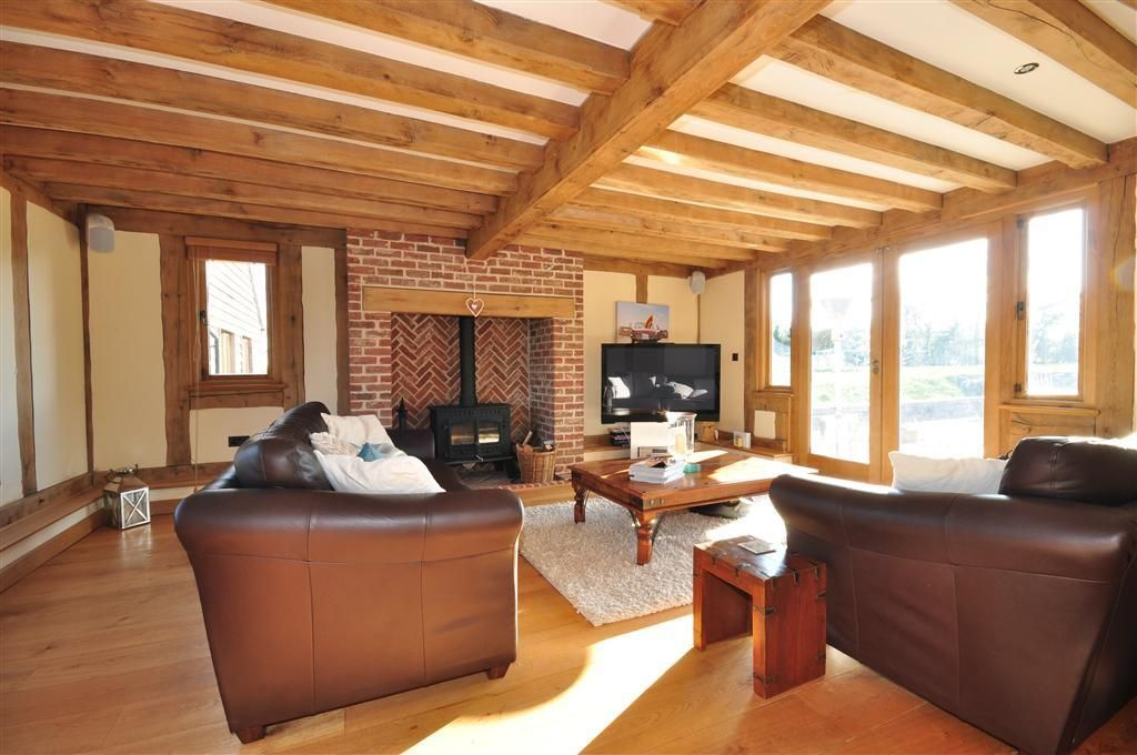 room with brick and leather sofa brick fireplace fireplace