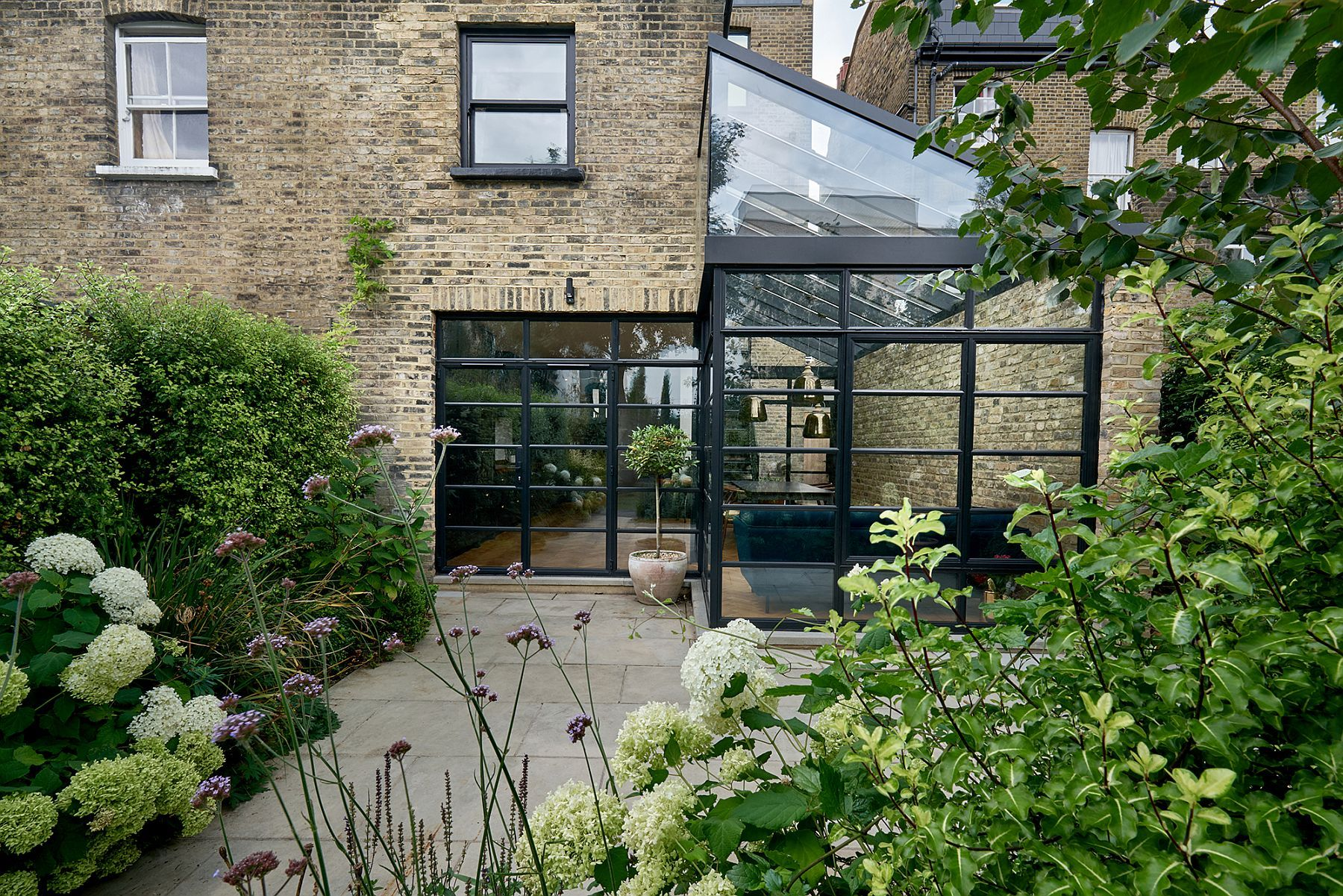 Terrace garden details - Modern Extension Using Crittall Windows Refreshes Victorian Terrace House