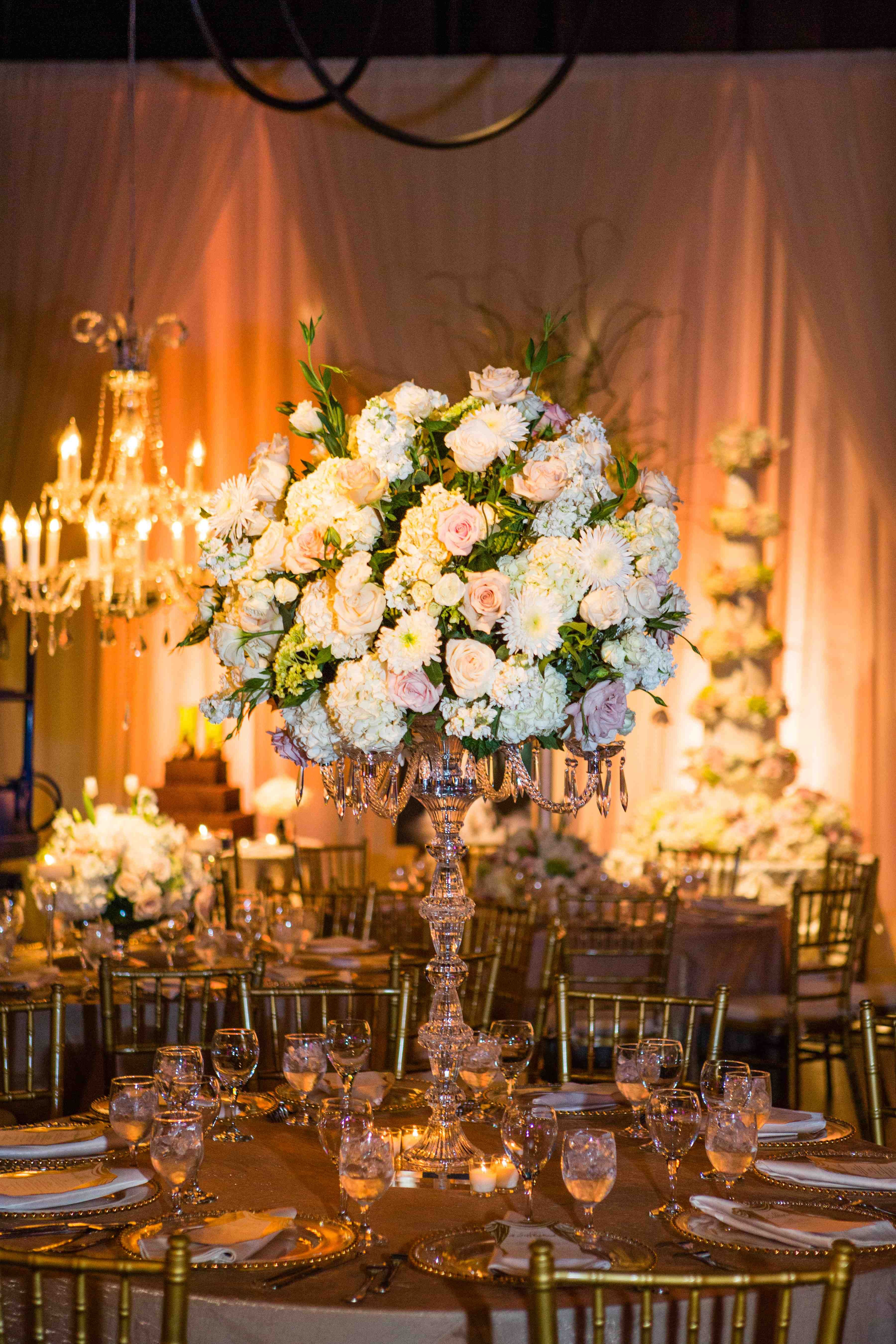 Chandeliers to enhance the beauty of the floral centerpieces.. bling bling