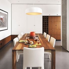 A walnut and white design makes a bright modern space feel warm and welcoming.