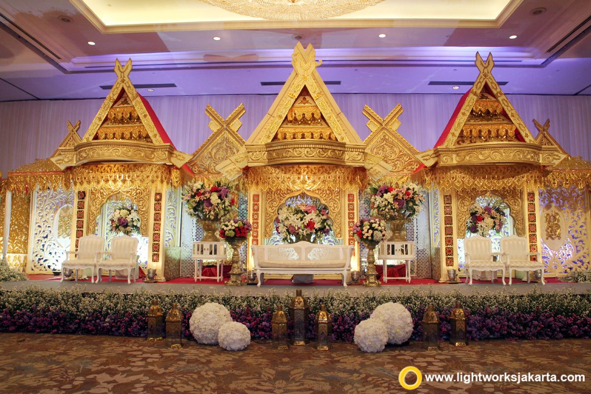 the traditional wedding of makassar great combination of gold and red for the wedding stage - Traditional Hotel Decoration