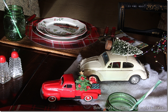Volkswagen and pickup truck bringing home Christmas trees on dinner table