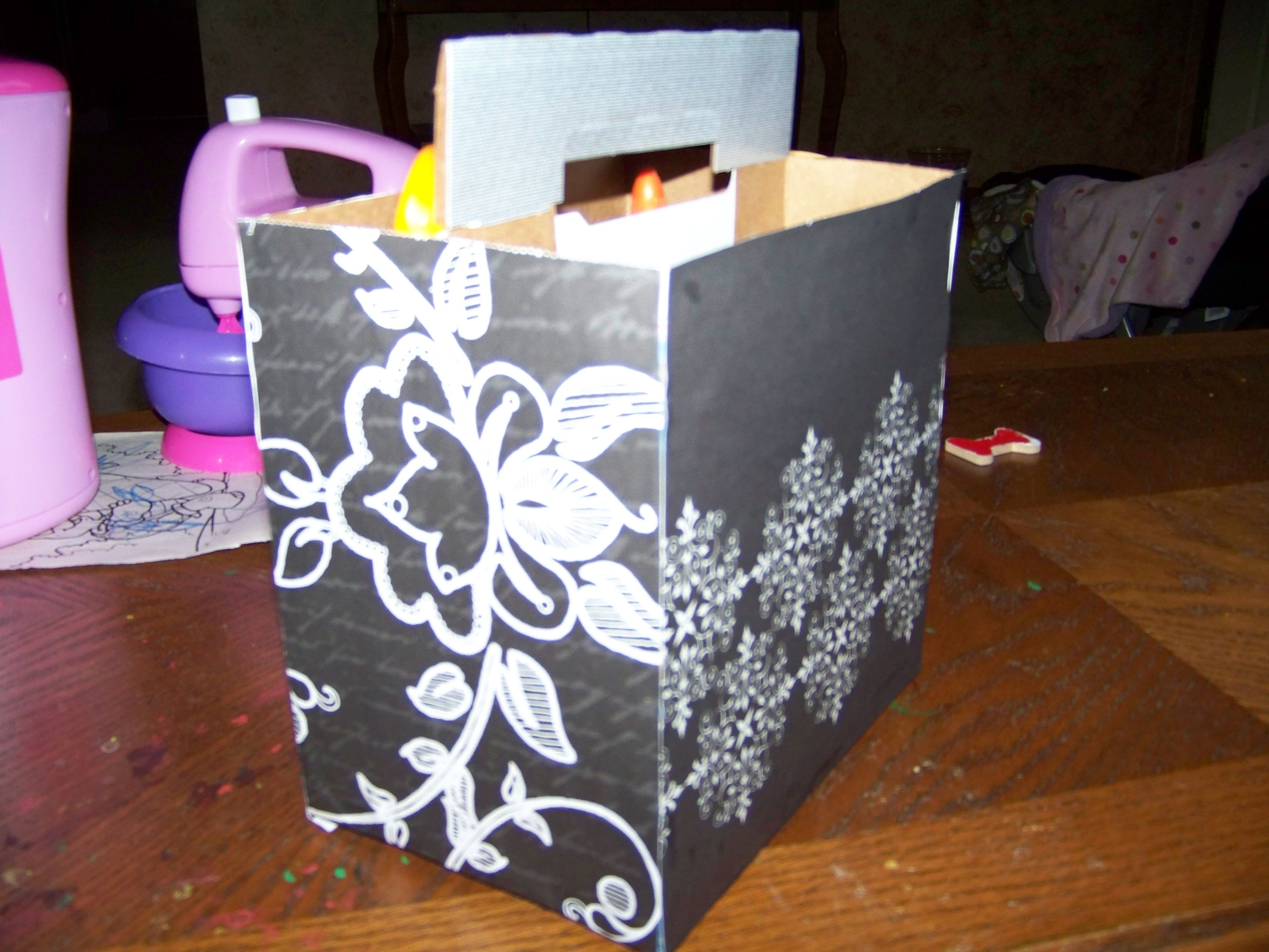 Scrapbook paper carrying case - I Took An Empty Six Pack Holder And Covered It In Scrapbook Paper To Make It