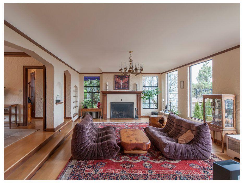 Living Room:Wood Coffee Table Trim Purple Sofa Textured Walls Art ...