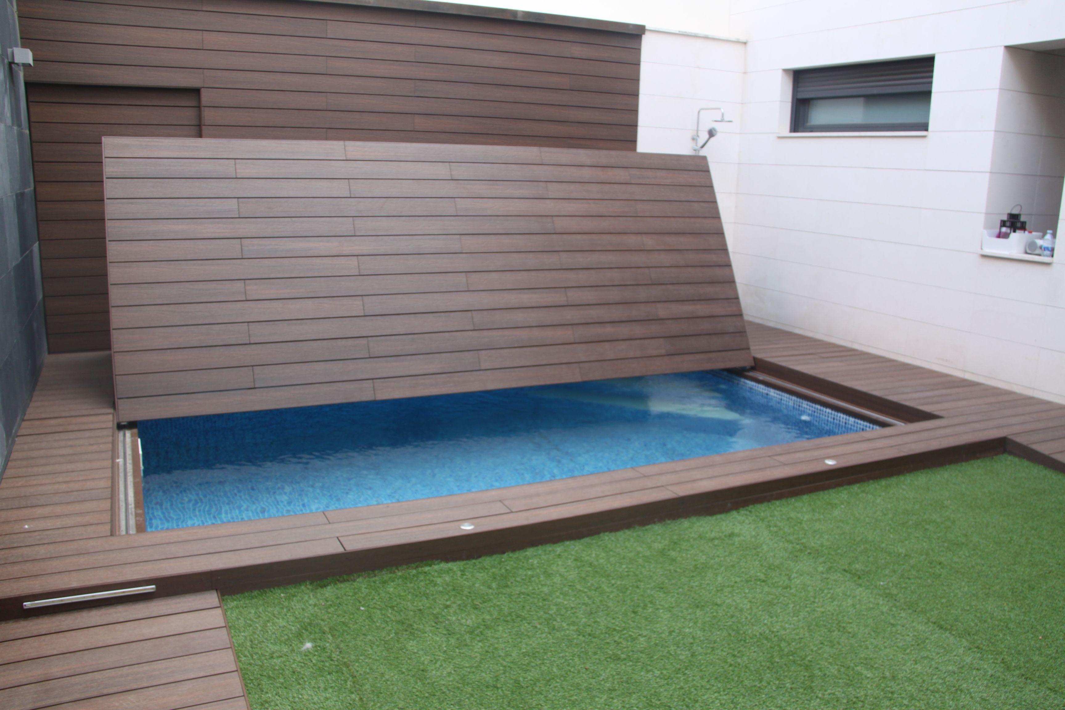 Piscina oculta apertura hacia la pared terminaci n en for Cubierta piscina transitable