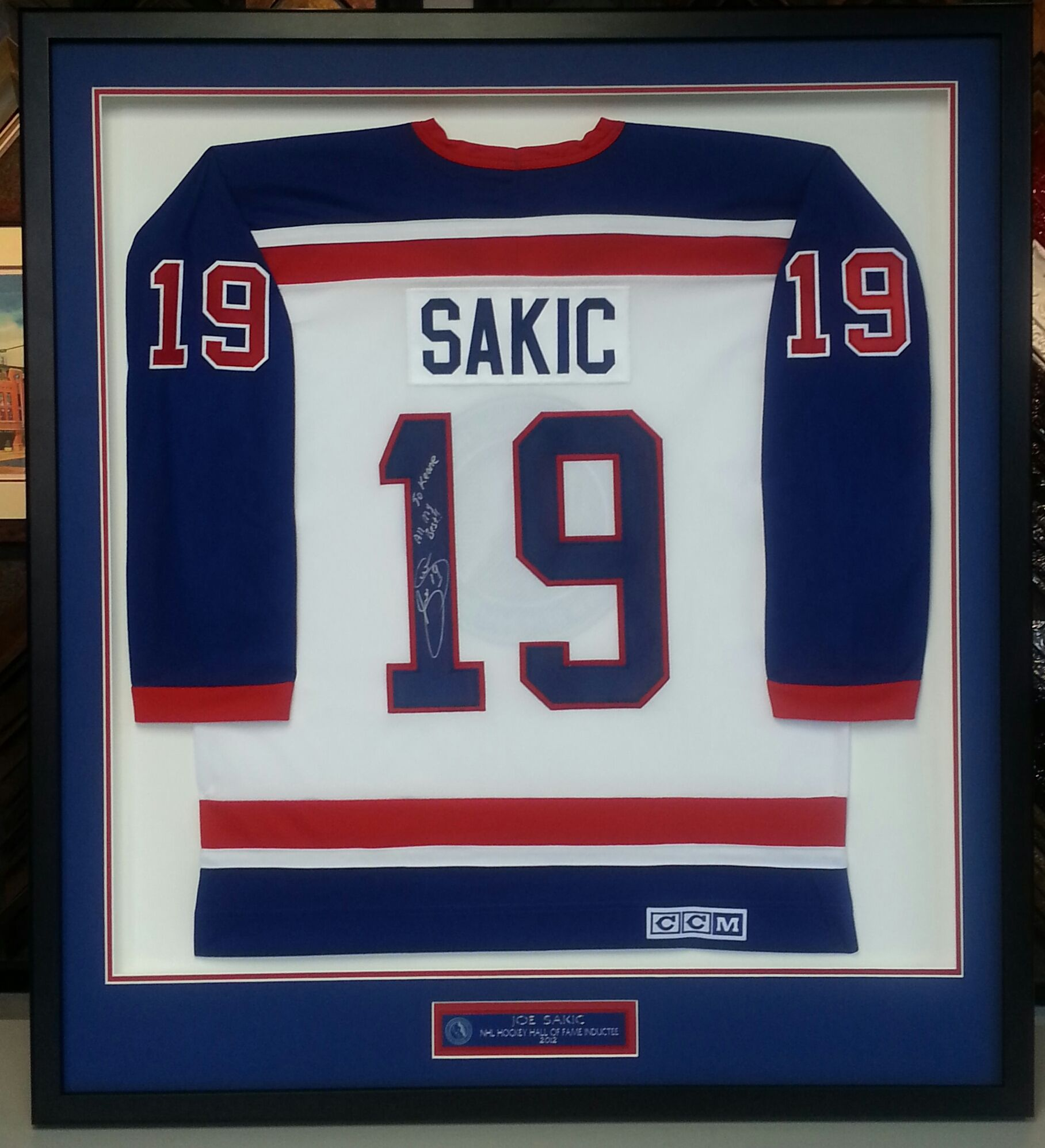 Custom framed Joe Sakic Hall of Fame Hockey jersey. Custom framed by  FastFrame of LoDo. 9d01ea0de