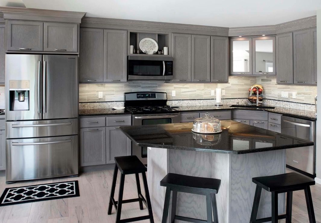 a kitchen remodel in north wales pennsylvania features gray cabinetry stainless steel on kitchen id=62250
