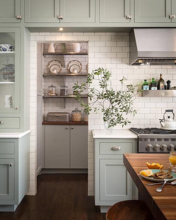 Farmhouse Green Kitchen Cabinets: White Subway Tile Adds To This Kitchen Pantry's Farm Style