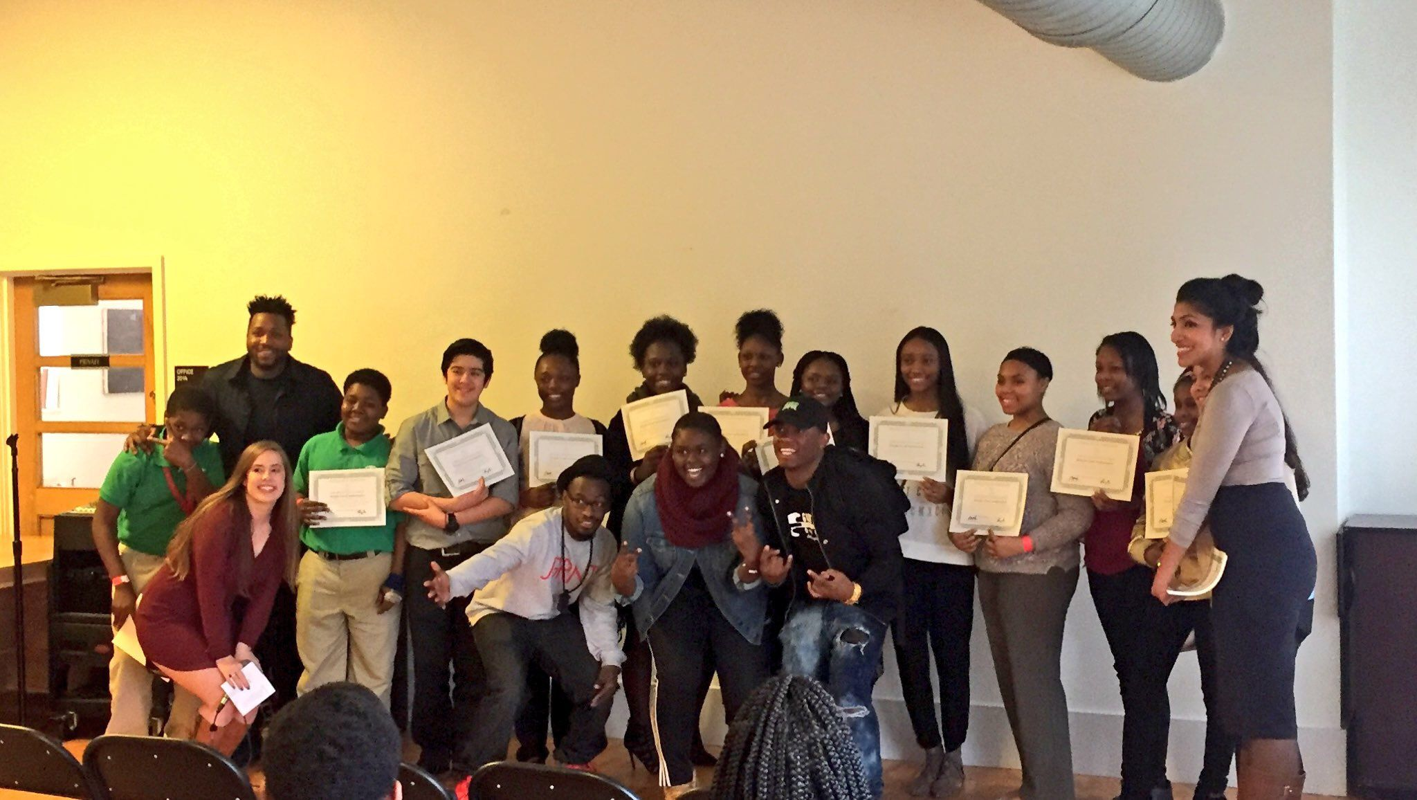 #TheSimpleGood students showcasing their certificates and sharing a group photo with #Chicago artists after their showcase at the Art in Public Life Incubator in #HydePark #Chicago