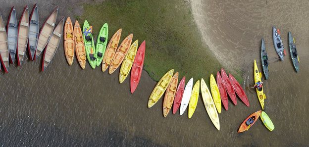 A kayaks line the shore of Lake Jean at Ricketts Glen State Park, Red Rock, Pa., on Thursday, July 4, 2013. (AP Photo/Bloomsburg Press Enterprise, Jimmy May)