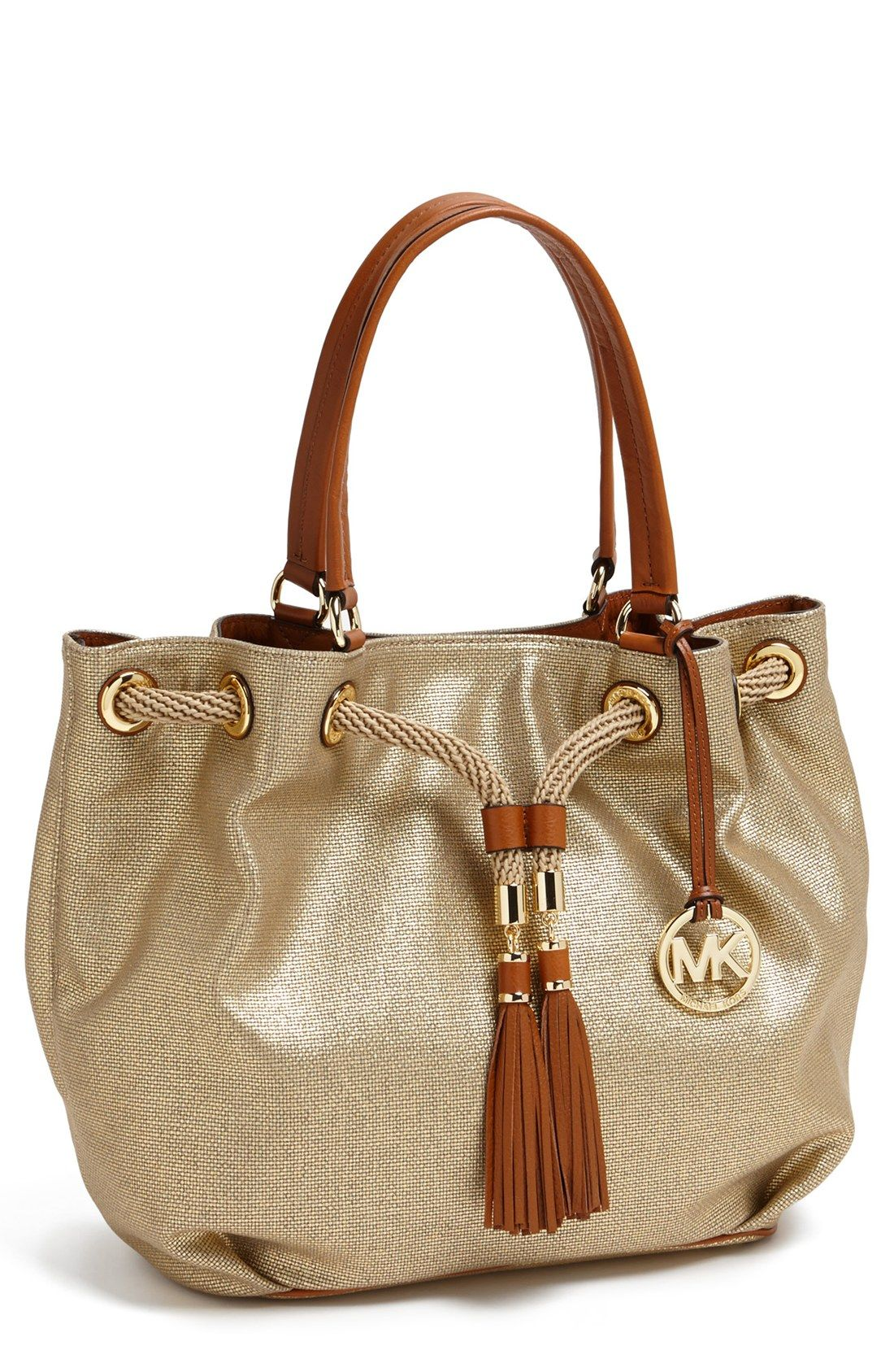 adcc1f756359 Loving this Michael Kors nautical inspired tote with tasseled-rope  drawstrings.