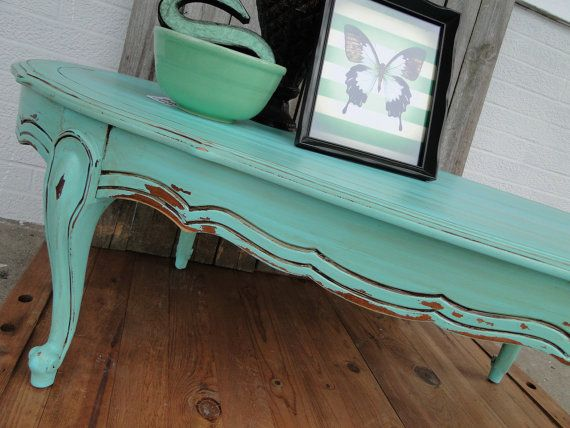 vintage wooden oval coffee table with cuvy legs in distressed aqua