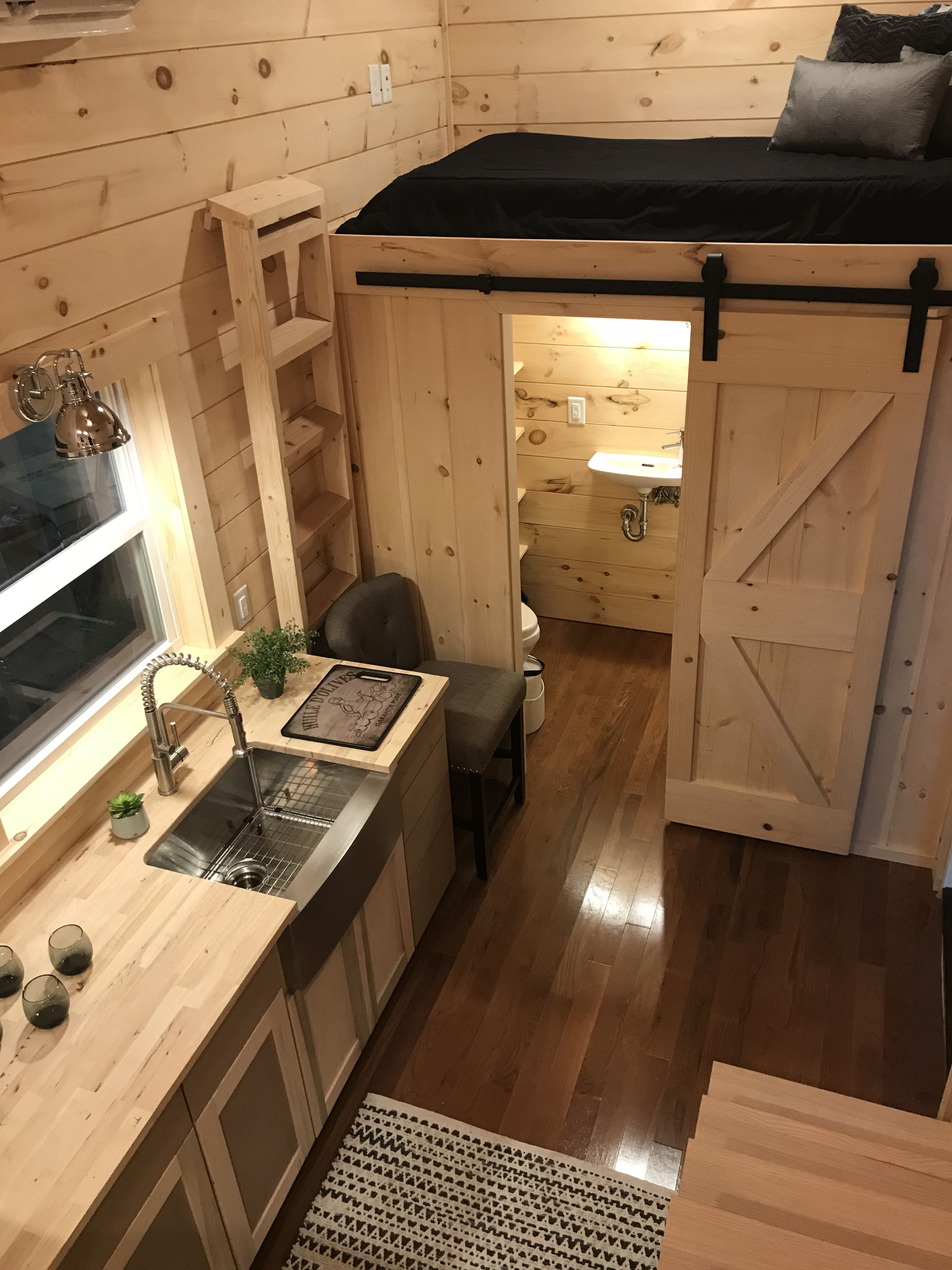 Sweet Dream is an 8′ x 22′ Incredible Tiny Home with a base price of $36,250 plus the customer's chosen upgrades.  This home has an approximate weight of 10,560 pounds.  Sweet Dream features a reverse loft, stairs with storage, and 3 closets.  This custom-built home also has a butcher block counter top, 3/4″ Kentucky Oak hardwood floors in Winchester, Shiplap, under the bed storage, half-moon sink, and many other custom features. #countertop