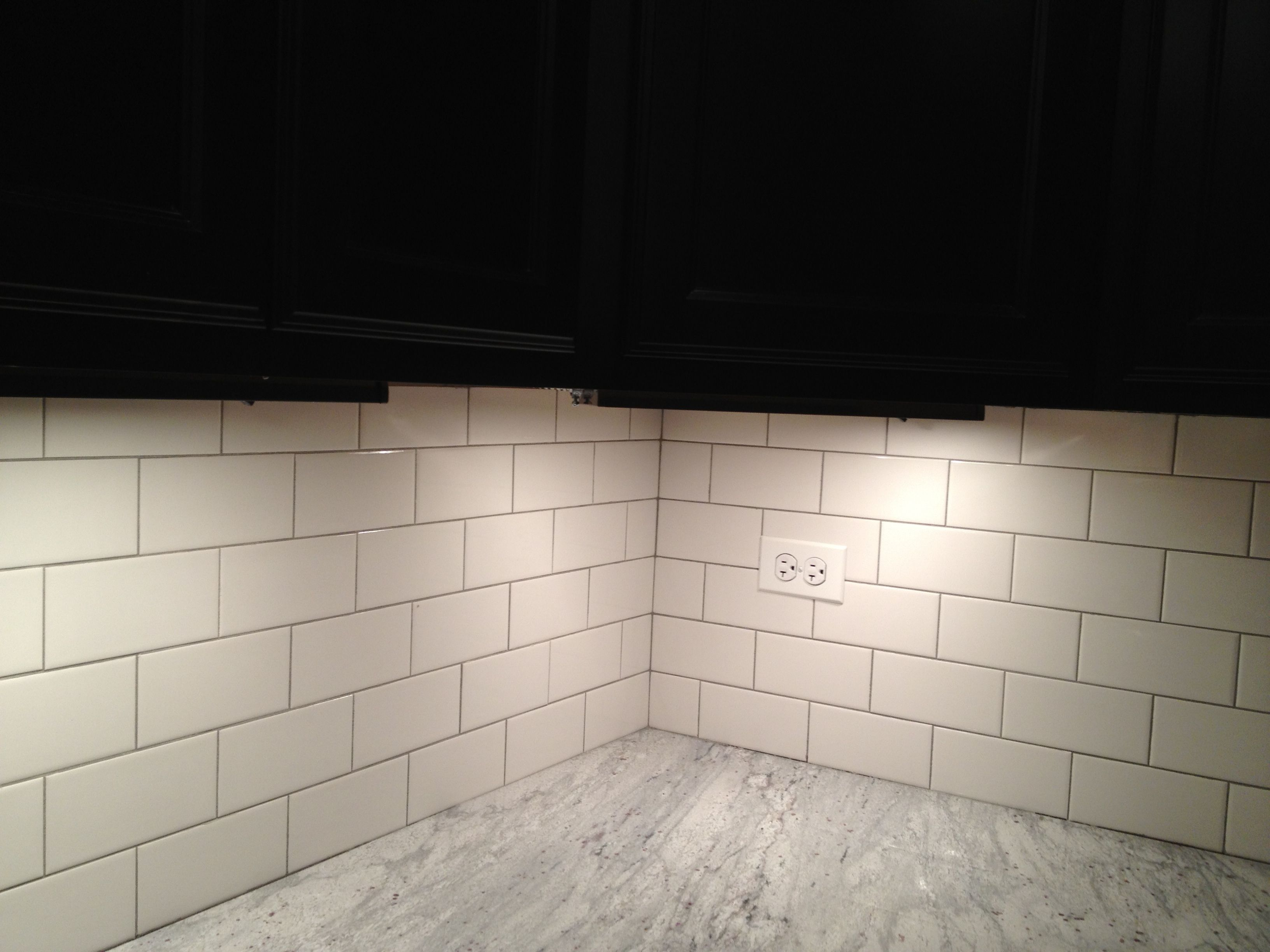 light gray grout with brick pattern white subway tile back ...