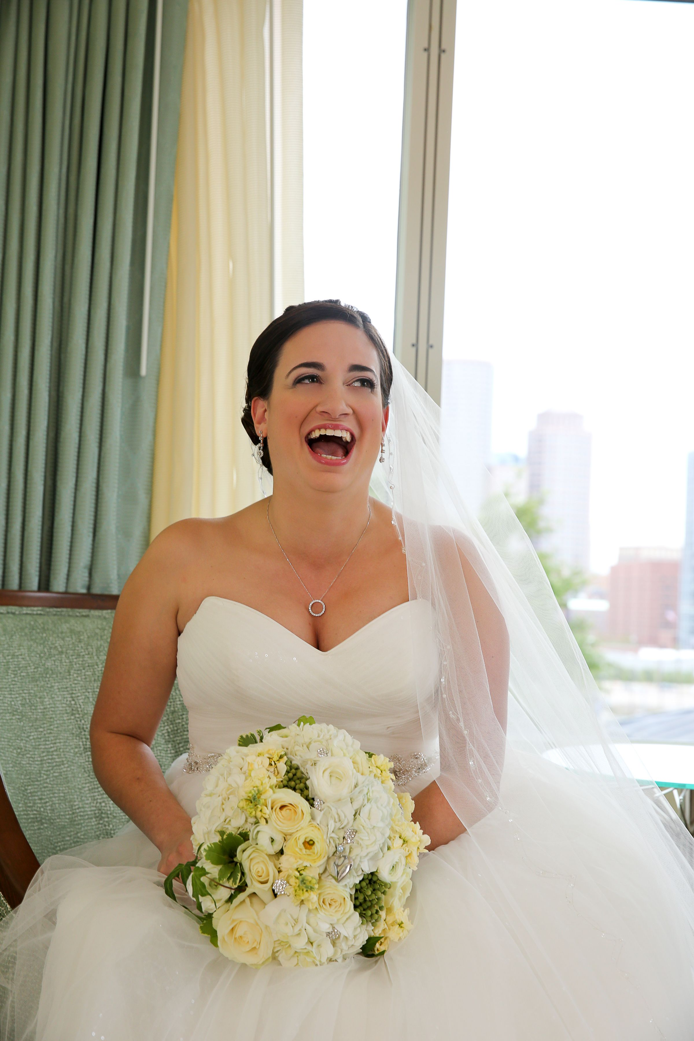 Morning wedding dresses  Laughing bride the morning of her wedding For more wedding