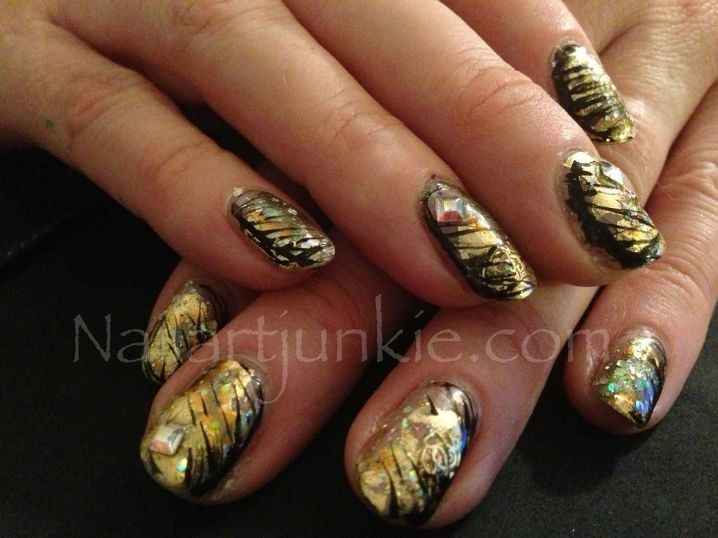 Here is something sweet for your nails - try this fancy manicure using gold mother of pearl with dark chocolate drizzle.