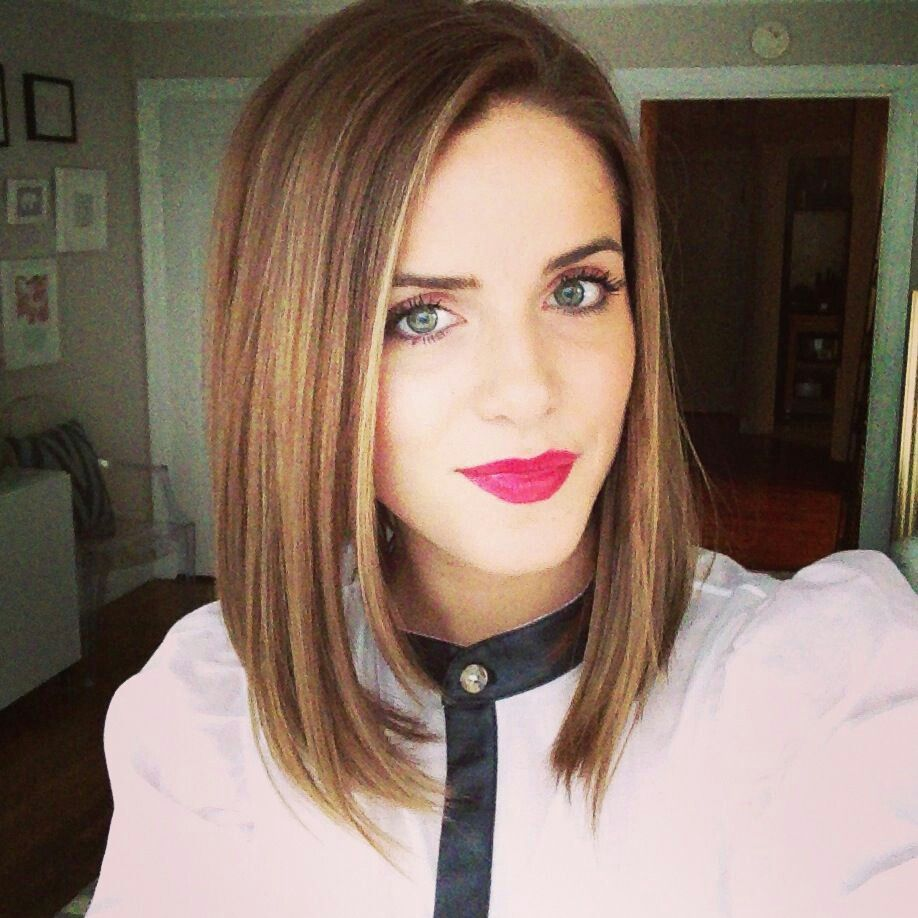ash brown hair with blonde streaks and highlights in an angled lob